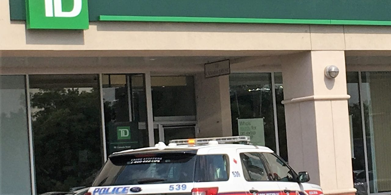 Suspects at large in mid-morning bank robberies