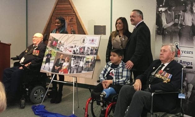 Nine-year-old Markham amputee unveils War Amps commemorative envelope