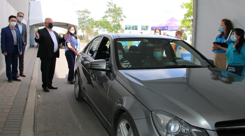 Leaders thank workers at drive-thru vaccination clinic